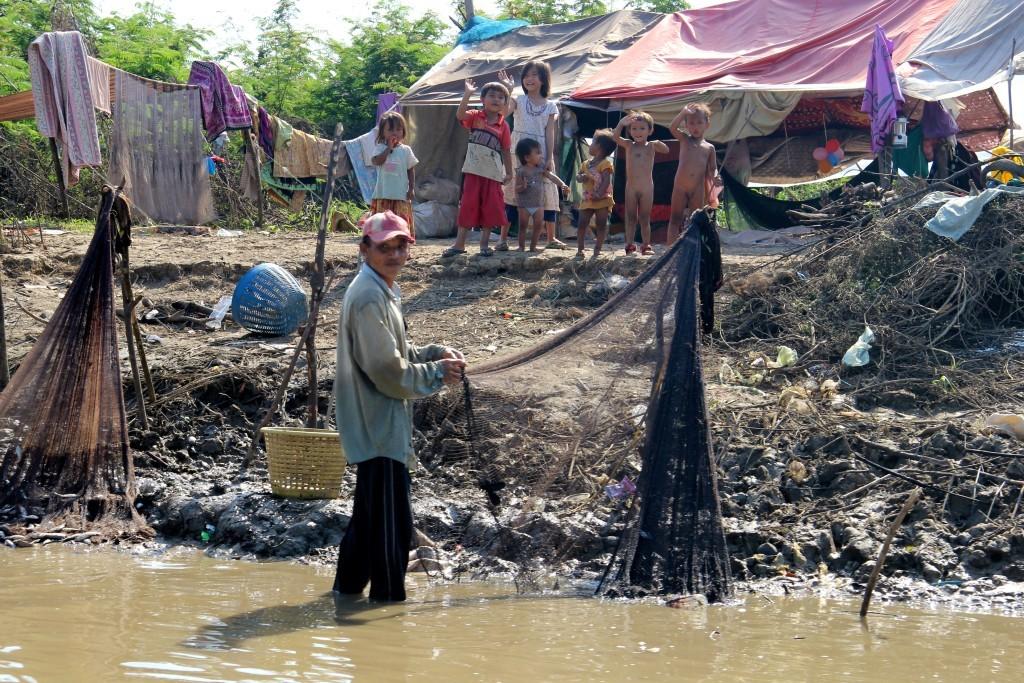 Fischerfamilie auf dem Mekong